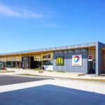 Contemporary design associating wood and zinc as facade materials