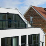 An unusual roof shape designed in respect of the neighbouring properties