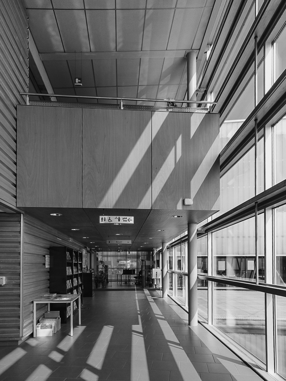 Bright internal corridor distributing all workshop rooms